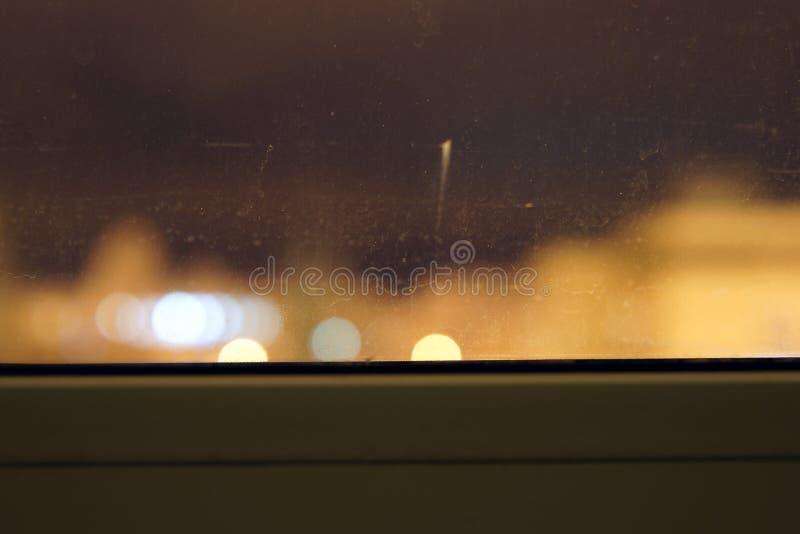 Janela e bokeh de Misted Foto atmosférica da noite fotografia de stock royalty free
