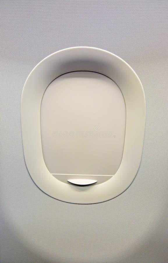 Janela fechado do avião fotografia de stock royalty free