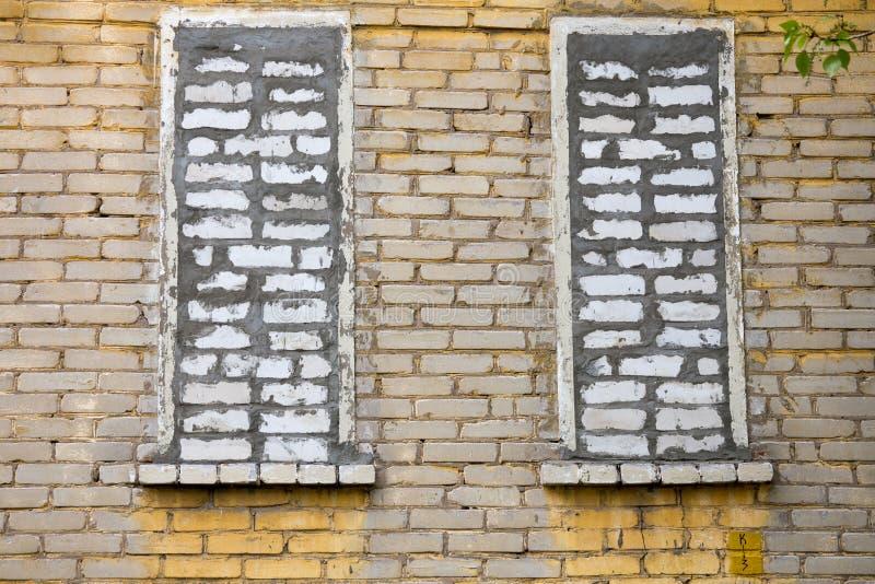 Janelas de Bricked foto de stock