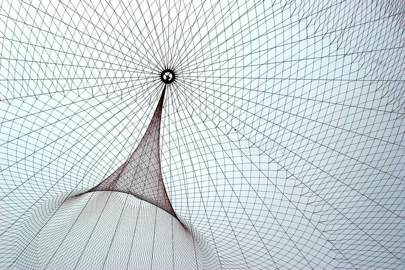 Janet Echelman`s public network sculpture in roundabout stock photography