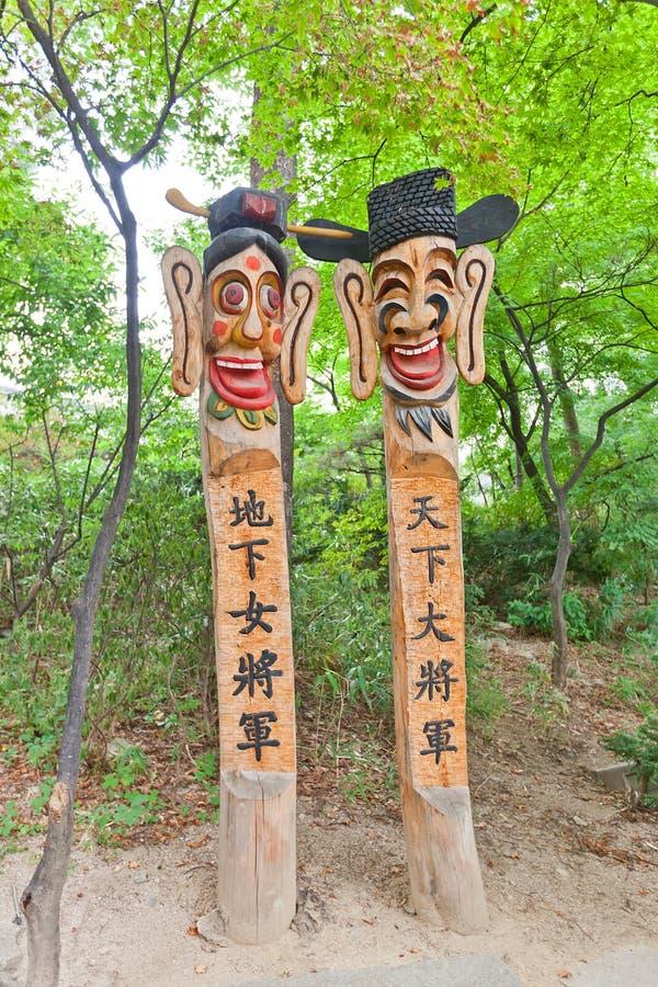 Jangseung totem poles in Namsangol Hanok Village of Seoul. Jangseung totem poles in Namsangol Hanok Village museum of Seoul, Korea. Jangseung frighten away royalty free stock photography