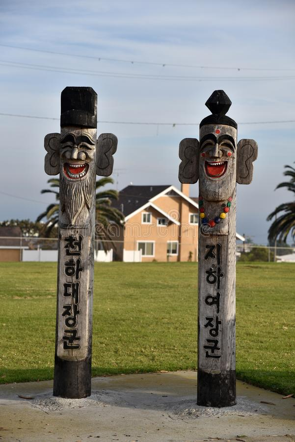 Jangseung totems protect the Temple of the Korean Friendship stock photos