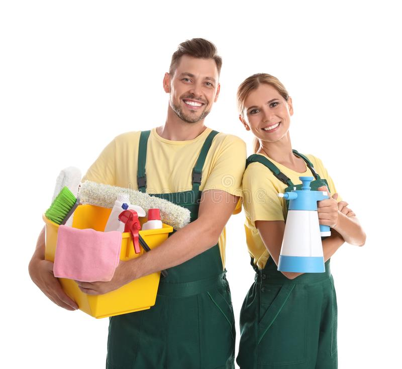 Janitors with cleaning supplies. On white background royalty free stock image