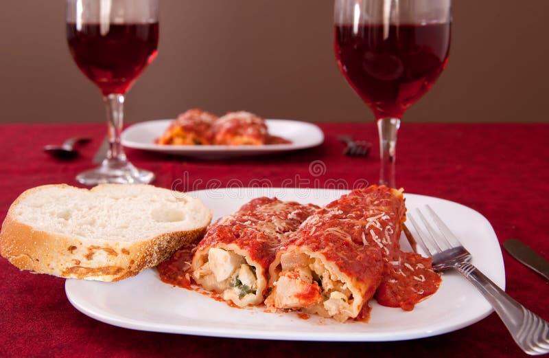 Jantar de Manicotti imagem de stock royalty free