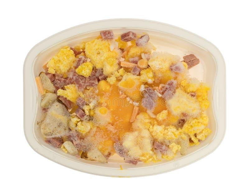 Jantar de tevê congelado do café da manhã dos ovos e das batatas do presunto imagem de stock