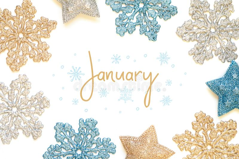 January calligraphy inscription with shining snowflakes. And stars royalty free stock photo