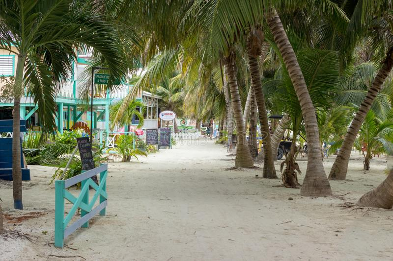 Looking North down the street from the water taxi terminal toward The Split. January 20 2018, Caye Caulker, Belize. Looking North down the street from the water stock photos