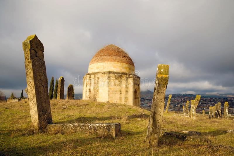 January gloomy day at an old Muslim cemetery. Eddie Gumbez mausoleum complex. Shamakhi, Azerbaijan royalty free stock image