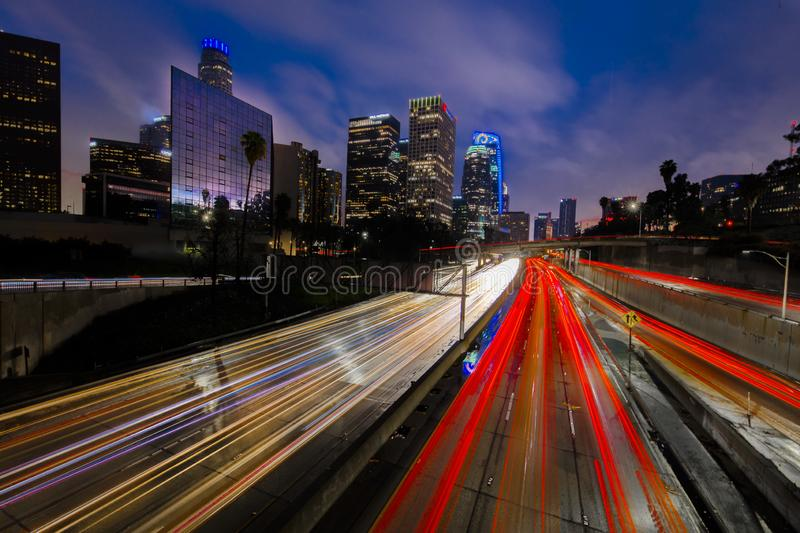 JANUARY 20, 2019, LOS ANGELES, CA, USA - California 110 South leads to downtown Los Angeles with streaked car lights at sunset stock images