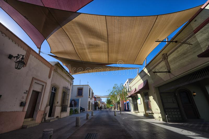 Barrio antiguo in Monterrey Mexico. January 16, 2016 Monterrey, Mexico: shade over the street in the historic old town called `Barrio Antiguo stock photo