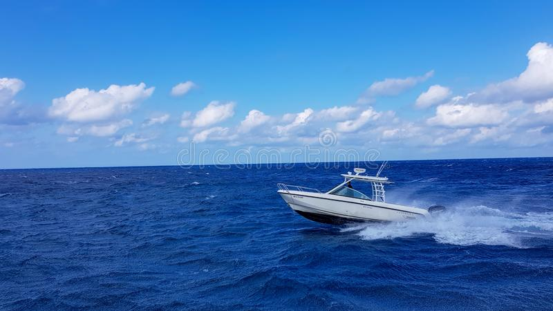 17 January 2018 - Nassau, Bahamas. Boston whaler boat jumping the waves in the sea and cruising the blue ocean day in royalty free stock photography