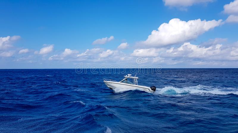 17 January 2018 - Nassau, Bahamas. Boston whaler boat jumping the waves in the sea and cruising the blue ocean day in stock photography