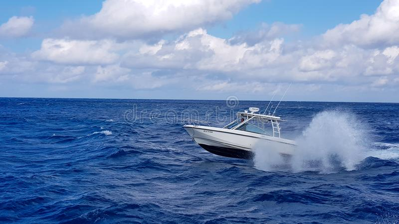 17 January 2018 - Nassau, Bahamas. Boston whaler boat jumping the waves in the sea and cruising the blue ocean day in stock photo