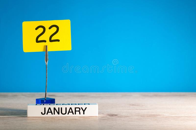 January 22nd. Day 222 of january month, calendar on blue background. Winter time. Empty space for text, mock up.  stock image