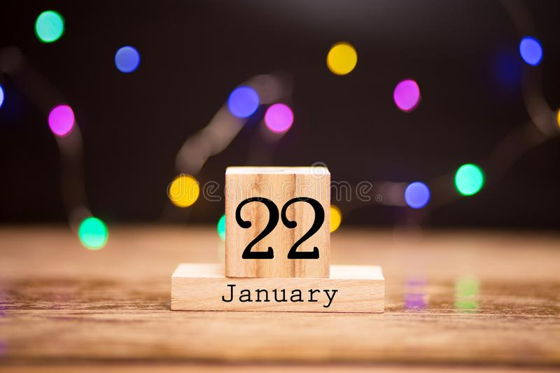 January 22nd. Day 22 of month, calendar on wooden background. Winter time. Year concept stock photos