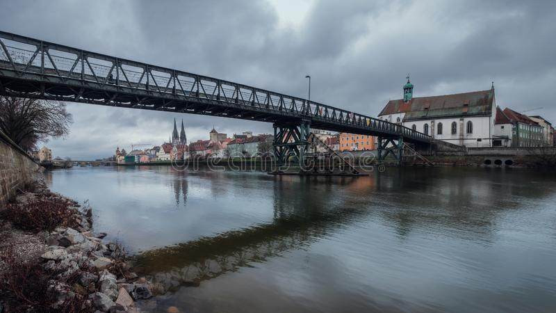 Panorama view from Danube on the bridge Eiserner Steg Regensburg and old town stock photography