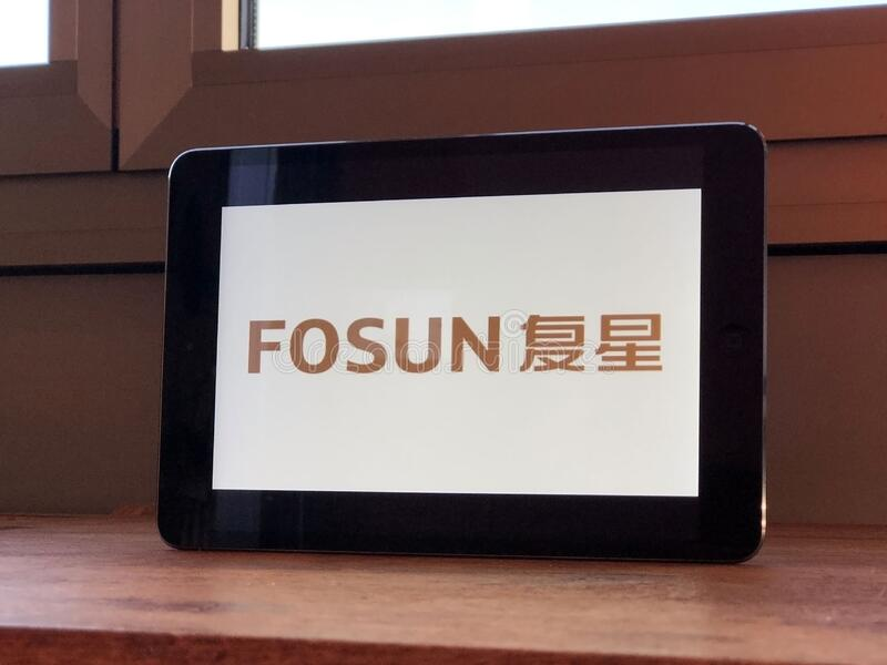 January 2020 Parma, Italy: Fosun company logo icon on tablet screen close-up. Fosun brand icon.  royalty free stock photography