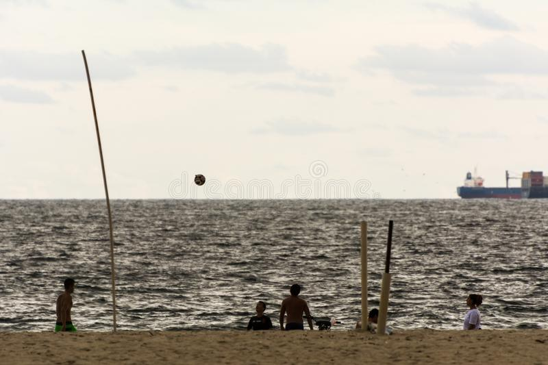 People playing football on the beach at the sunset, in Copacabana, Rio de Janeiro, Brazil. 2019, january. Rio de Janeiro, Brazil. People playing football on the stock photo