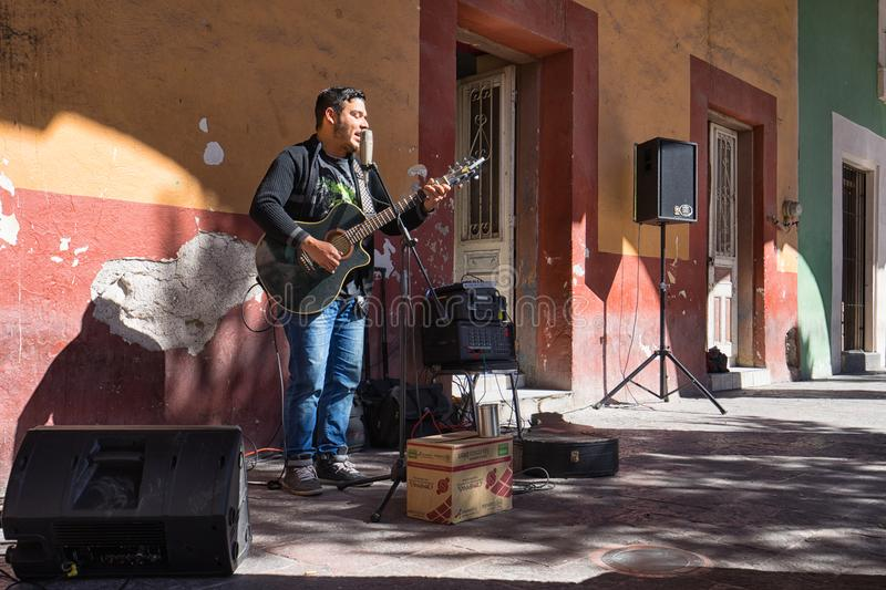 Street musician in Saltillo Mexico. January 17, 2016 Saltillo, Mexico: street musician performing for tips in the historic center of the city stock image