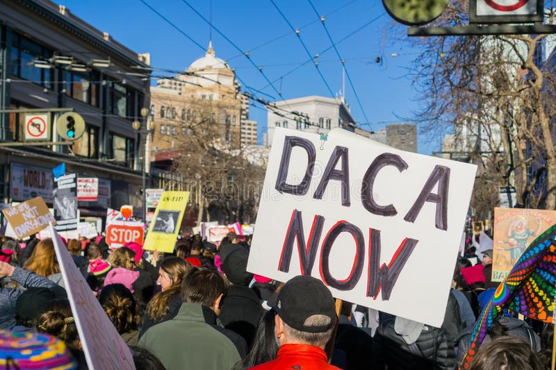 `Daca now` sign carried by a participant at the Women`s March. January 20, 2018 San Francisco / CA / USA - `Daca now` sign carried by a participant at the Women` stock image