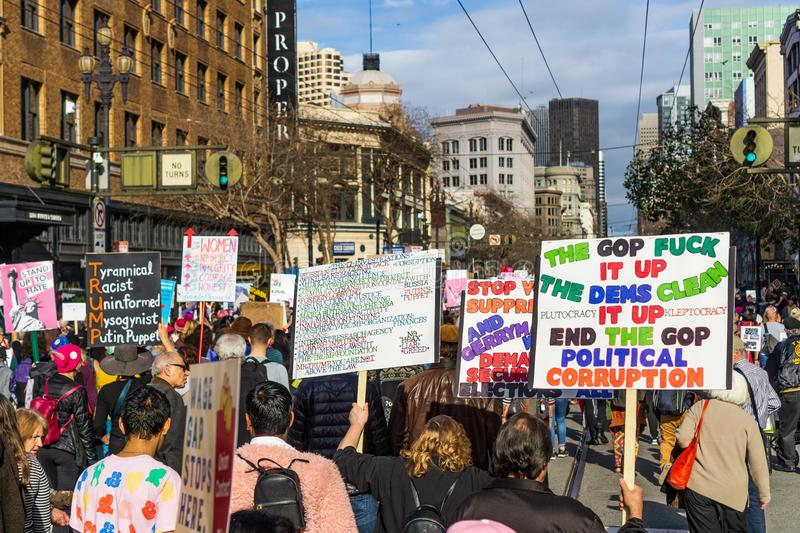 January 19, 2019 San Francisco / CA / USA - Participants to the Women`s March event hold signs with various messages stock images