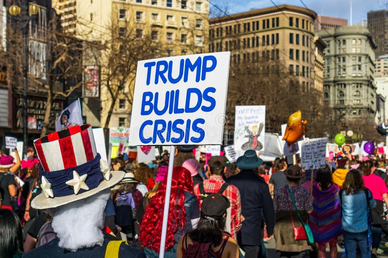 January 19, 2019 San Francisco / CA / USA - Women`s March `Trump builds crises` sign. January 19, 2019 San Francisco / CA / USA - Participants to the Women`s stock photo