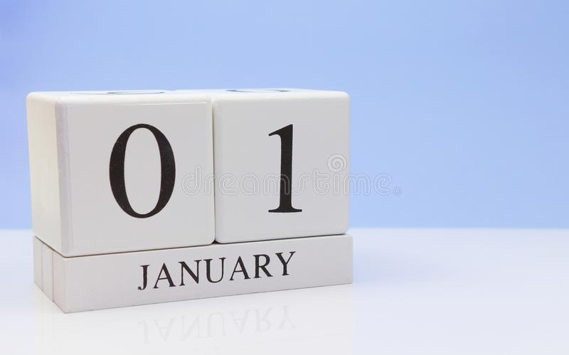 January 01st. Day 01 of month, daily calendar on white table with reflection, with light blue background. Winter time, empty space stock image