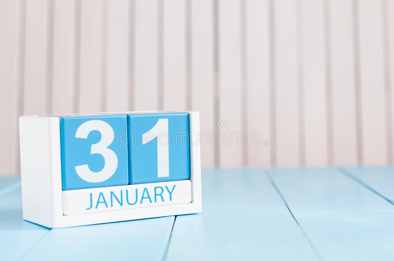 January 31st. Day 31 of month, calendar on wooden background. Winter at work concept. Empty space for text.  stock image