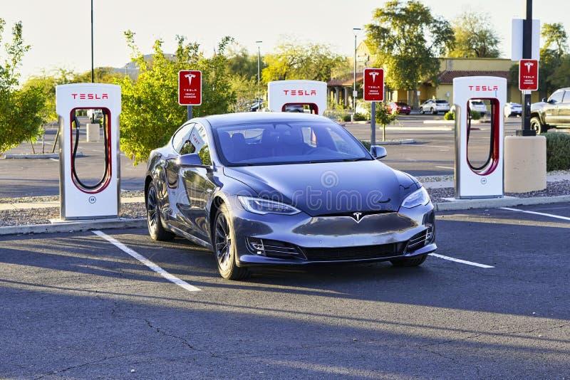 January 6, 2020 - Phoenix, AZ, USA: Tesla sedan recharging at an in-network Supercharger station in Phoenix, Arizona, USA. royalty free stock image