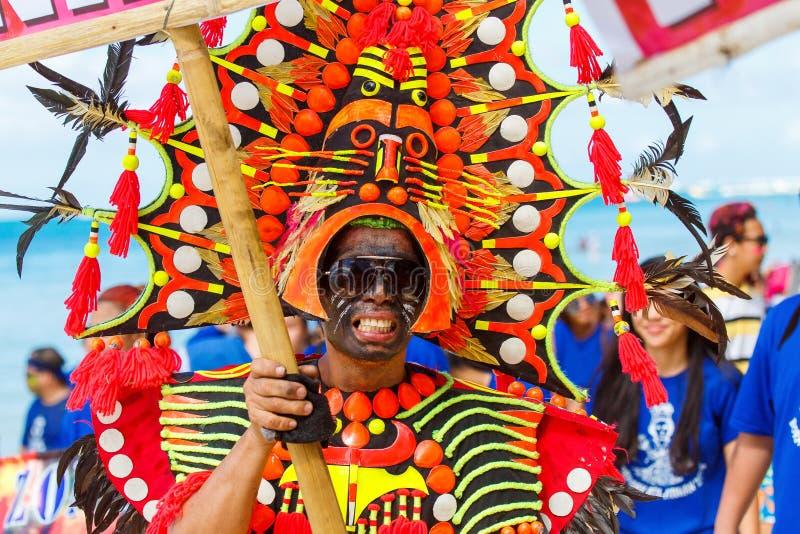 January 10th 2016. Boracay, Philippines. Festival Ati-Atihan. U. Nidentified people on parade in carnival costumes. Documentary Editorial Image stock photos