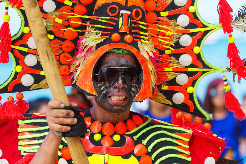 January 10th 2016. Boracay, Philippines. Festival Ati-Atihan. U. Nidentified people on parade in carnival costumes. Documentary Editorial Image stock photo