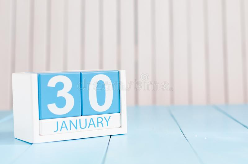 January 30th. Day 30 of month, calendar on wooden background. Winter at work concept. Empty space for text.  stock photography
