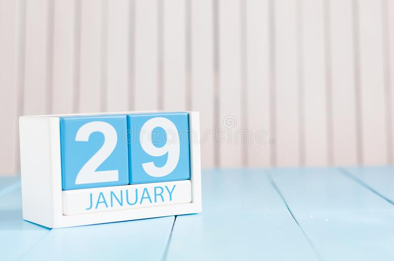 January 29th. Day 29 of month, calendar on wooden background. Winter at work concept. Empty space for text.  royalty free stock photo