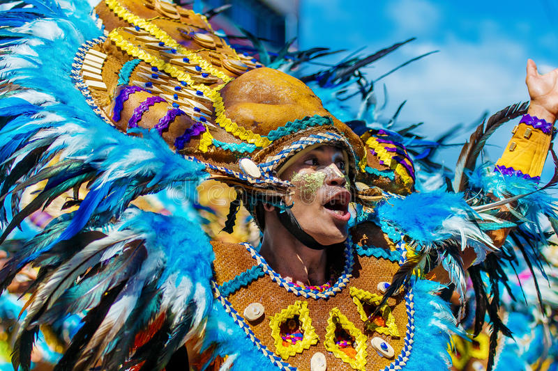 January 24th 2016. Iloilo, Philippines. Festival Dinagyang. Unidentified people on parade in carnival costumes. Documentary. Editorial Image royalty free stock photography