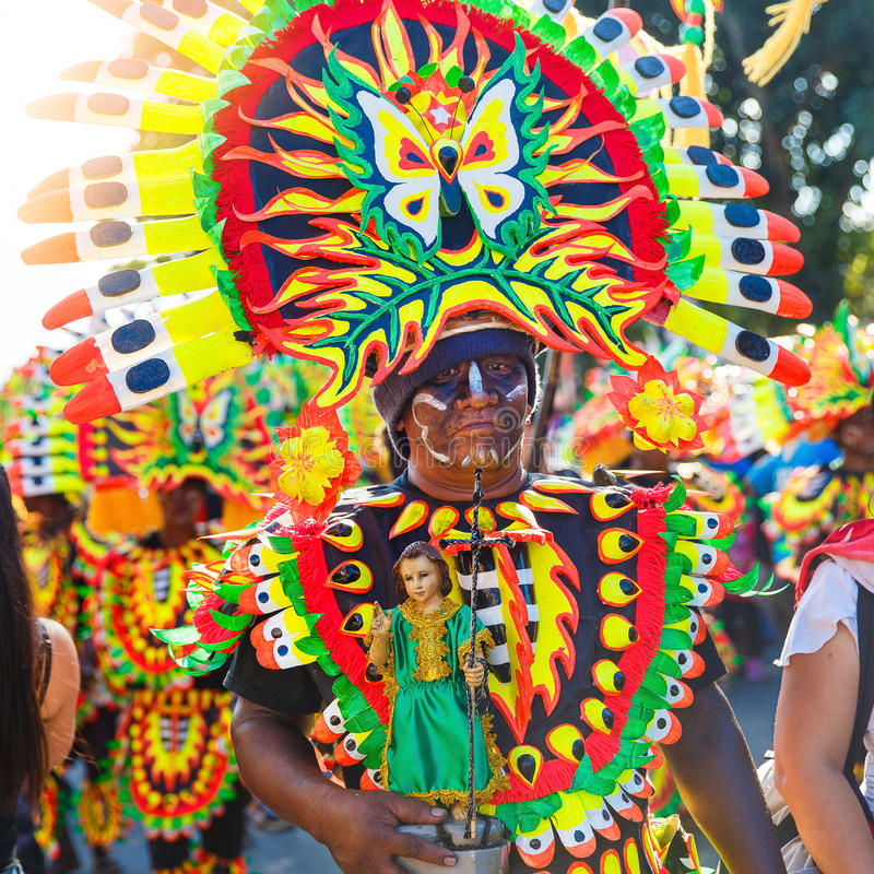 January 17th 2016. Kalibo, Philippines. Festival Ati-Atihan. Uni. Dentified people on parade in carnival costumes. Documentary Editorial Image royalty free stock photography