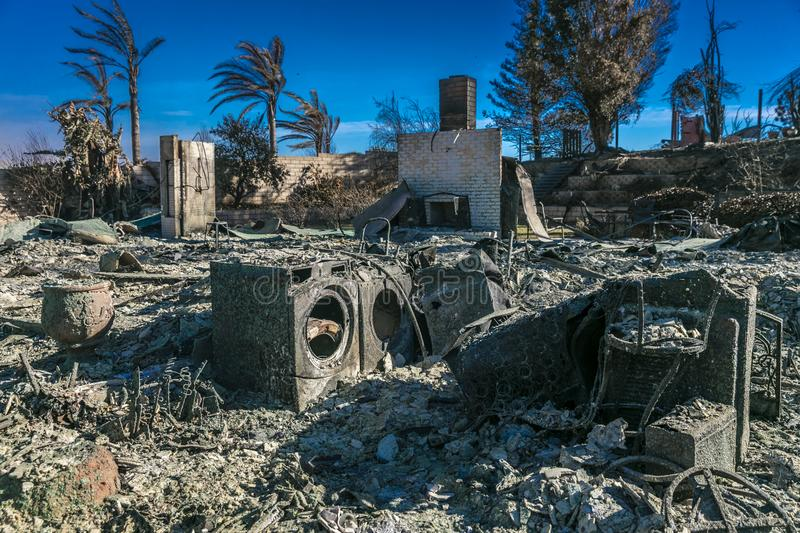 JANUARY 2018, VENTURA CALIFORNIA - Destroyed home and washer/drier from 2018 Thomas Fire off. Smoldering, minivan royalty free stock images