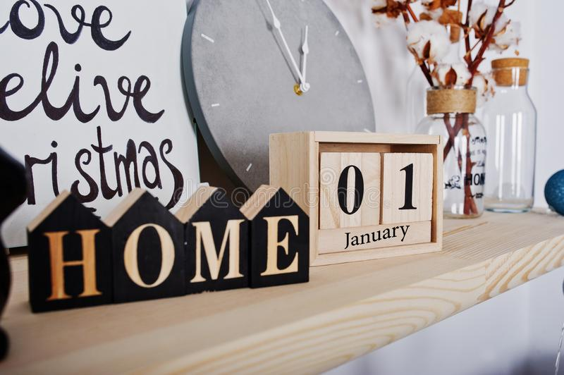 1 January wooden calendar with home sign. Happy winter holidays stock photo