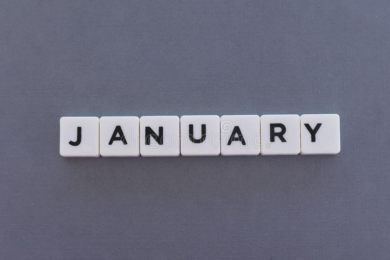 January word made of square letter word on grey background. Month time new year day date monthly calendar concept text winter reminder design number hello diary royalty free stock images