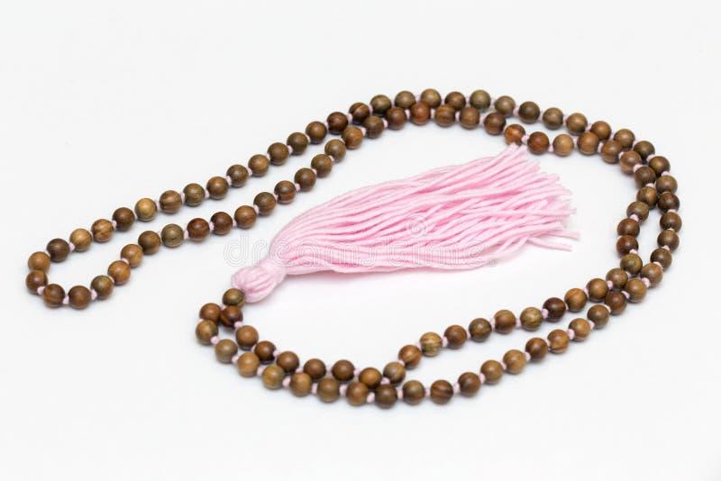 Japa mala  rosary of sandalwood beads 108 stock photo