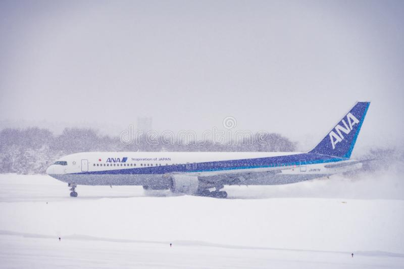 Japan Airline ready to Flight. Japan Airline Airplane ready to Flight in Snowing. So cool royalty free stock photos