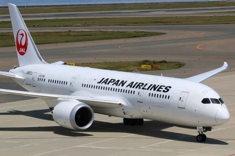 Japan Airlines Boeing 787 Dreamliner Nagoya Airport. Nagoya, Japan - May 23, 2014: A Japan Airlines Boeing 787 Dreamliner with the registration JA827J taxis at stock photography