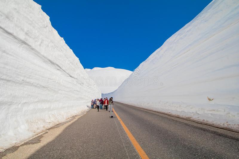 The japan alps or the snow mountains wall of Tateyama Kurobe alpine in sunshine day with blue sky background is one of the. The japan alps  or the snow mountains stock photo