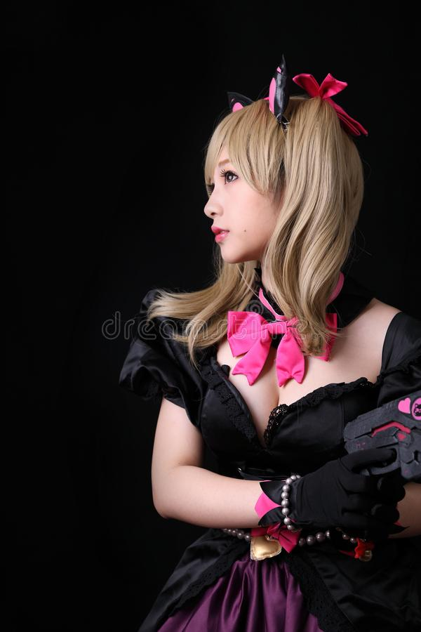 Japan anime cosplay, portrait of girl cosplay  in black background. Room stock photography