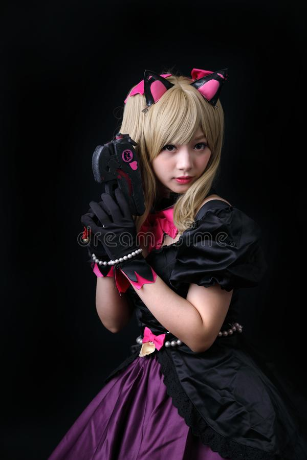 Japan anime cosplay, portrait of girl cosplay  in black background. Room royalty free stock photo