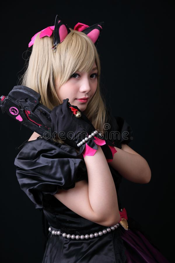 Japan anime cosplay , portrait of girl cosplay isolated in black background. Room stock photo