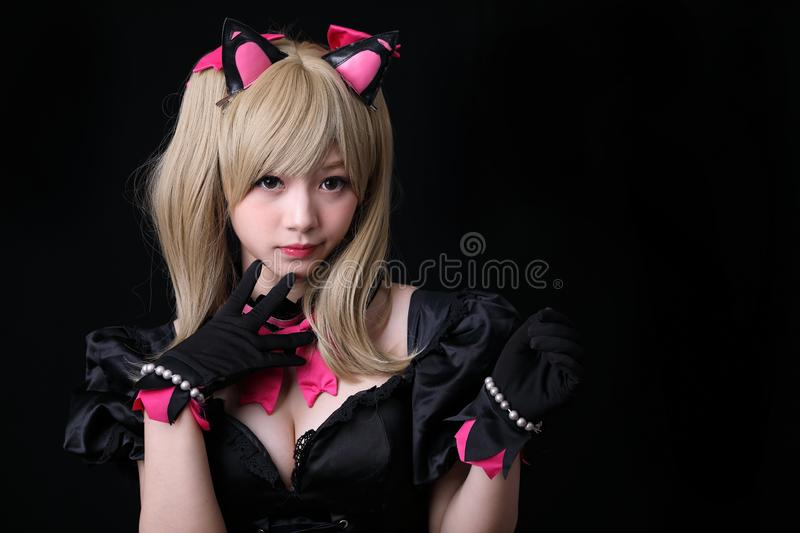 Japan anime cosplay, portrait of girl cosplay  in black background. Room royalty free stock photos