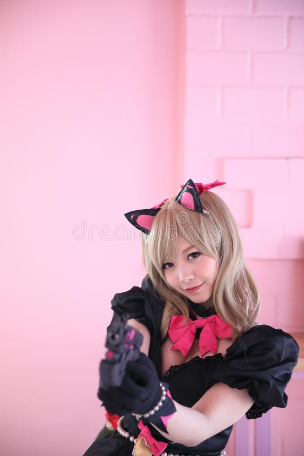 Japan anime cosplay , portrait of girl cosplay in pink room background. Japan anime cosplay , portrait of girl cosplay in pink room stock photo