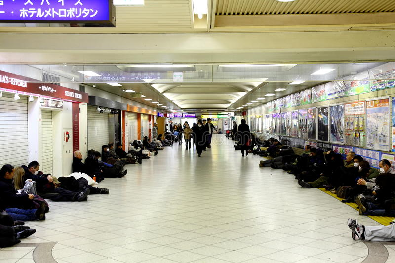 Japan Earthquake 2011. Many people are forced to spend the night in the subway. They can't go home by the trains and subway trains have ceased operation because royalty free stock image
