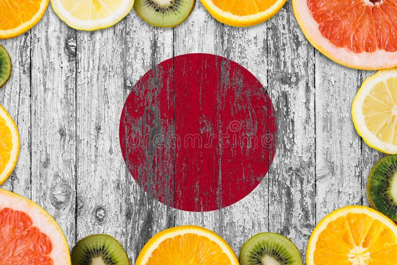 Japan food concept. Fresh fruits from traditional gardens. Cooking concept on wooden flag background stock photos