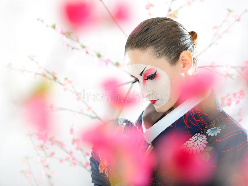 Japan Geisha Woman With Creative Make-up Stock Photo